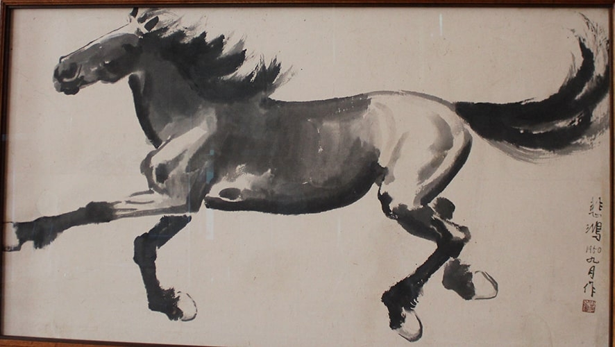 Black ink drawing of a horse galloping.