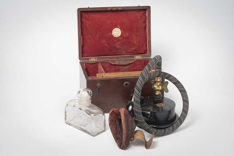 Ether inhaler, glass bottle and open wooden case.