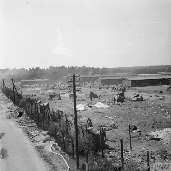 Black and white photograph of a concentration camp and fence.