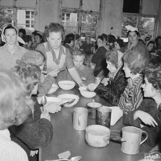 Black and white photograph of women eating soup.