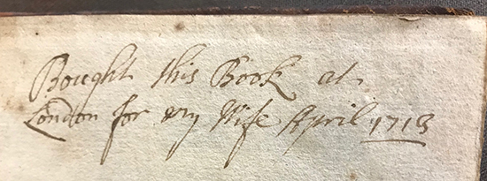 Handwritten inscription in a book: 'Bought this book at London for my wife, April 1713'