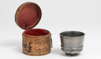 Antimony cup and leather case, 1630s