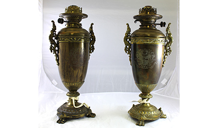 Two metal oil lamps