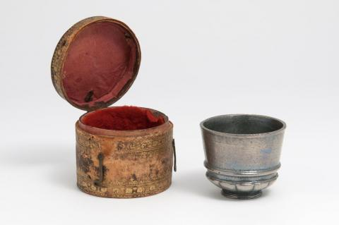 A metallic cup and decorated case