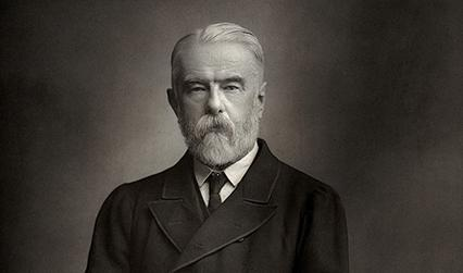 Black and white photograph of a white man with grey hair and a short beard.