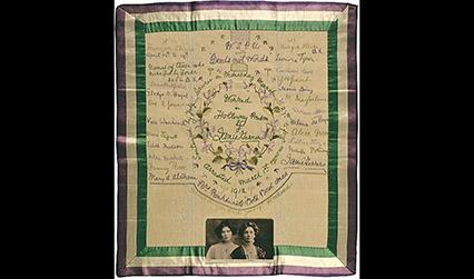 Embroidered handkerchief with a portrait photograph of two women at the bottom