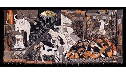 Photograph of a tapestry in shade sof brown and white, showing people, animals and the destruction of war