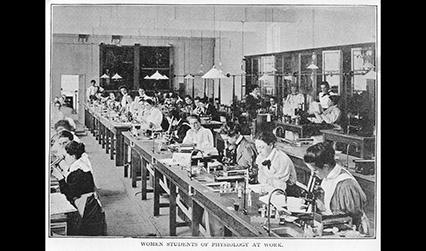 Black and white photograph of women studying in a laboratory