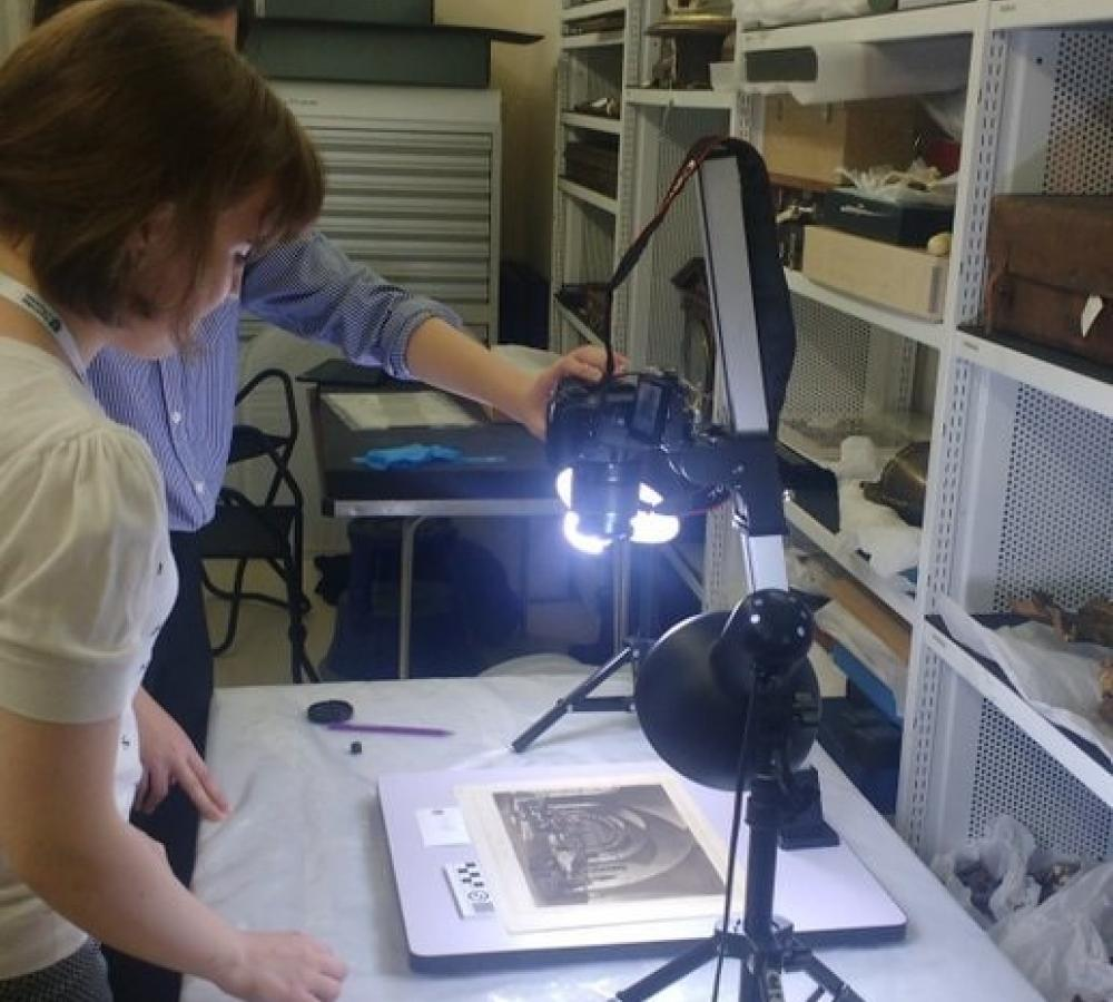 Volunteers photographing collections items