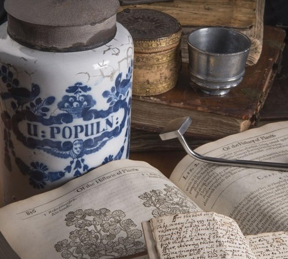 Apothecary Jar, antimony cup and rare book