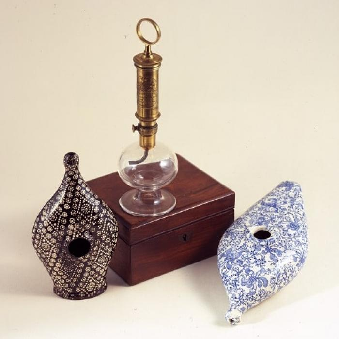 Ceramic feeding cups and brass breast pump, 19th century