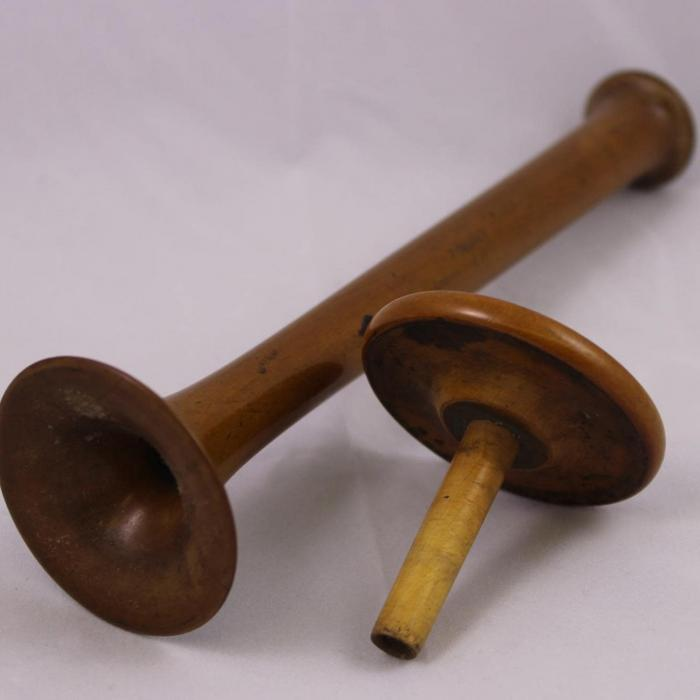 A turned wood monaural stethoscope.