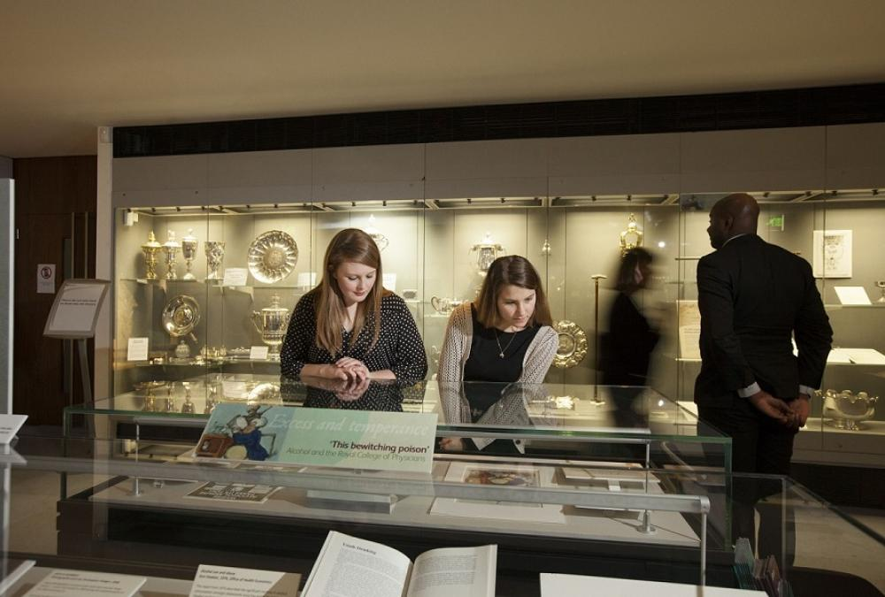 Visitors looking at a display case