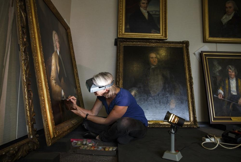 Conservator preserving a painting
